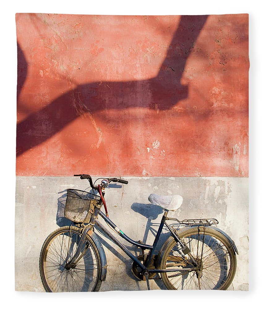 Chinese Culture Fleece Blanket featuring the photograph Bicycle Against Red Wall by Frankvandenbergh