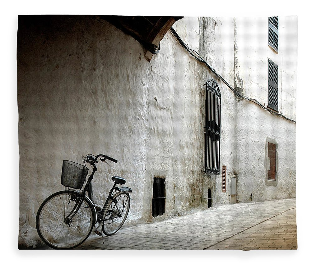 Tranquility Fleece Blanket featuring the photograph Bicycle Leaning Wall by Antonio R. Ramos