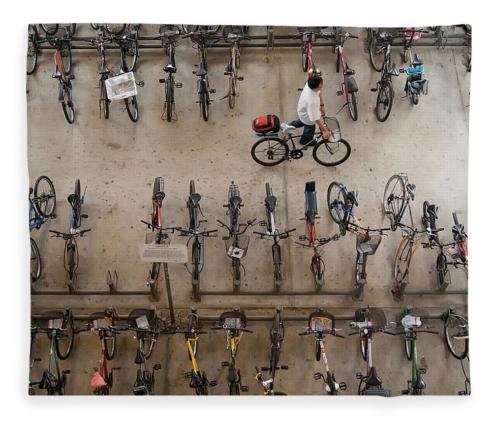 People Fleece Blanket featuring the photograph Bicycle Park At Boon Lay Mrt Station by Kokkai Ng