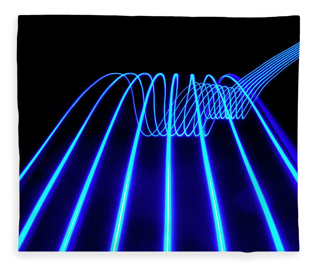 Laser Fleece Blanket featuring the photograph Blue Abstract Coloured Lights Trails by John Rensten