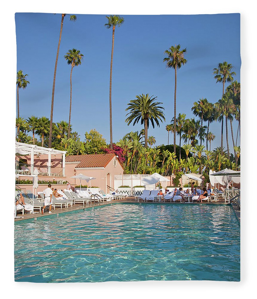 Tranquility Fleece Blanket featuring the photograph Blue-bottomed Pool Beneath Palm Trees by Barry Winiker