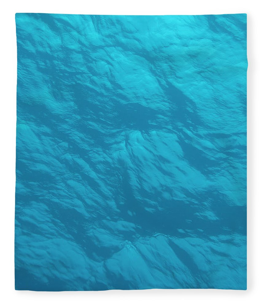 Tranquility Fleece Blanket featuring the photograph Blue Ocean Water Surface As Seen From by Jeff Hunter