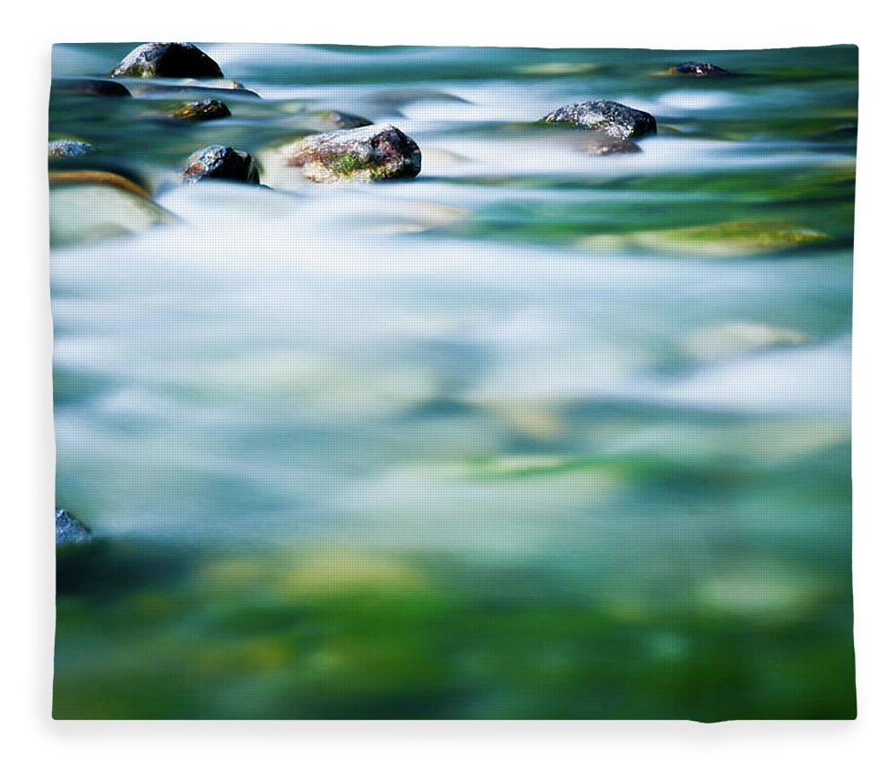 Scenics Fleece Blanket featuring the photograph Blurred River by Assalve