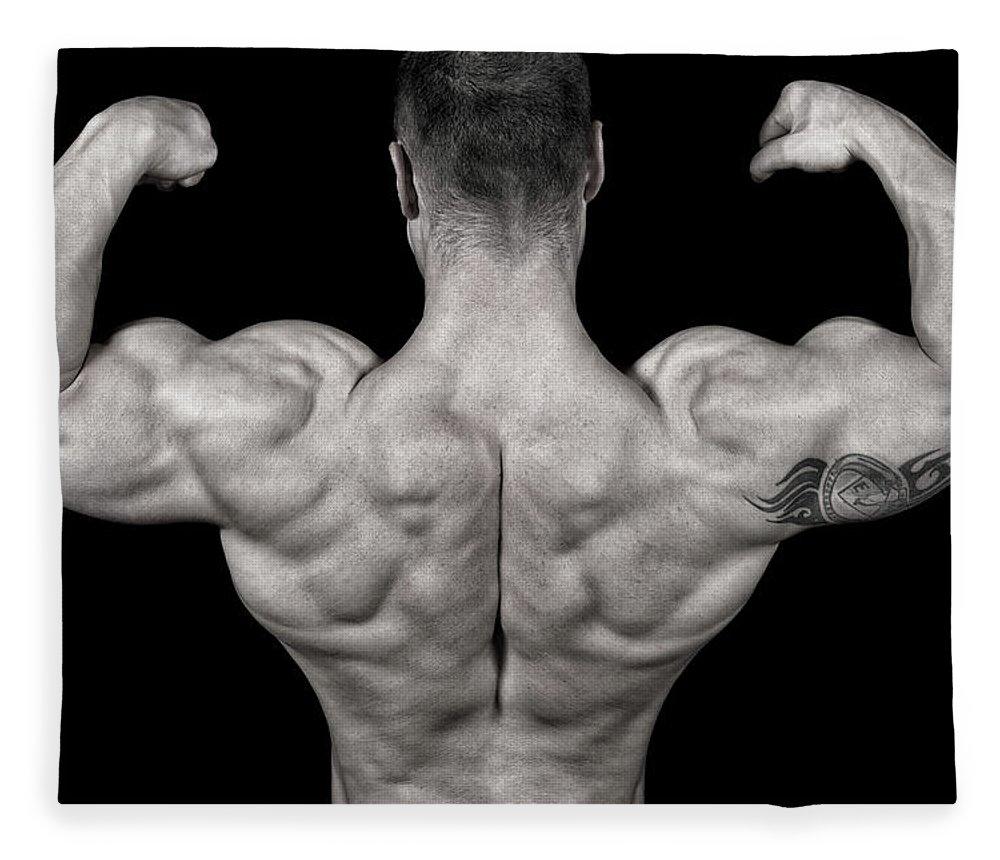 Toughness Fleece Blanket featuring the photograph Bodybuilder Posing by Vuk8691