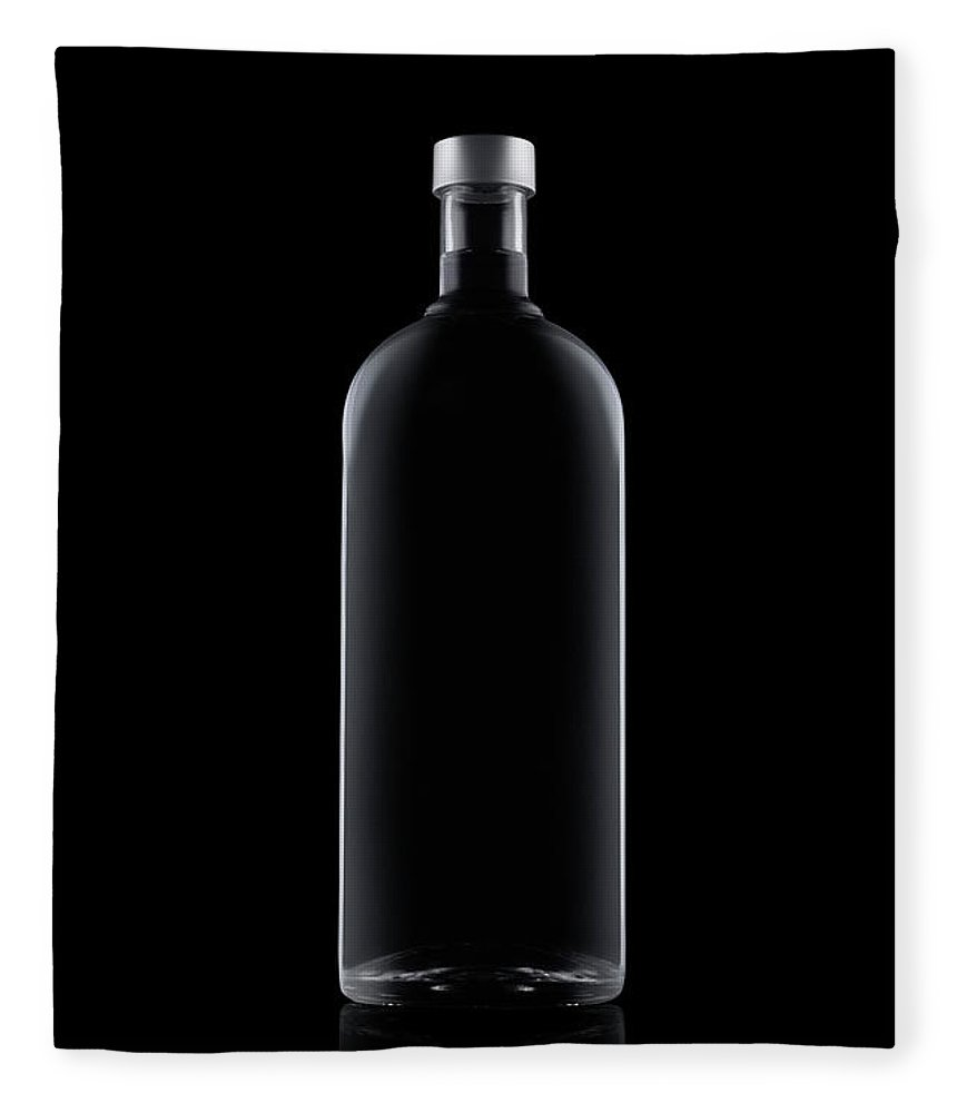 Black Color Fleece Blanket featuring the photograph Bottle Of Water Isolated On Black by Kedsanee