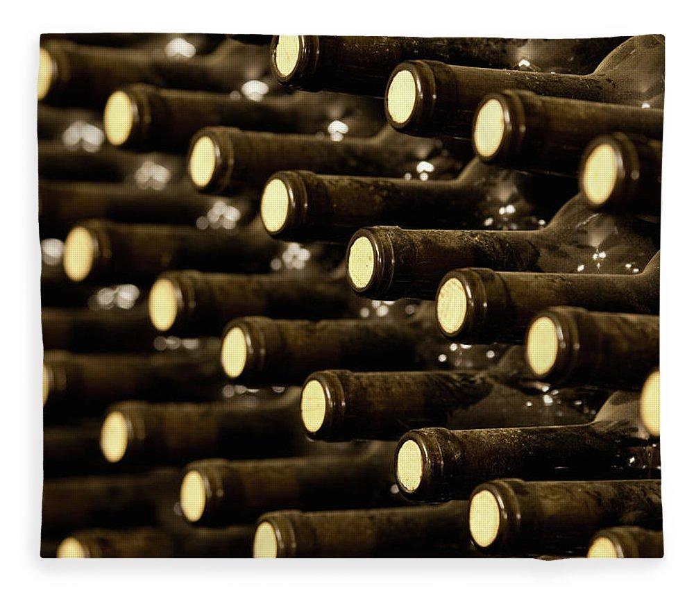 Stellenbosch Fleece Blanket featuring the photograph Bottled Red Wine Aging In Wine Cellar by Siegfried Layda
