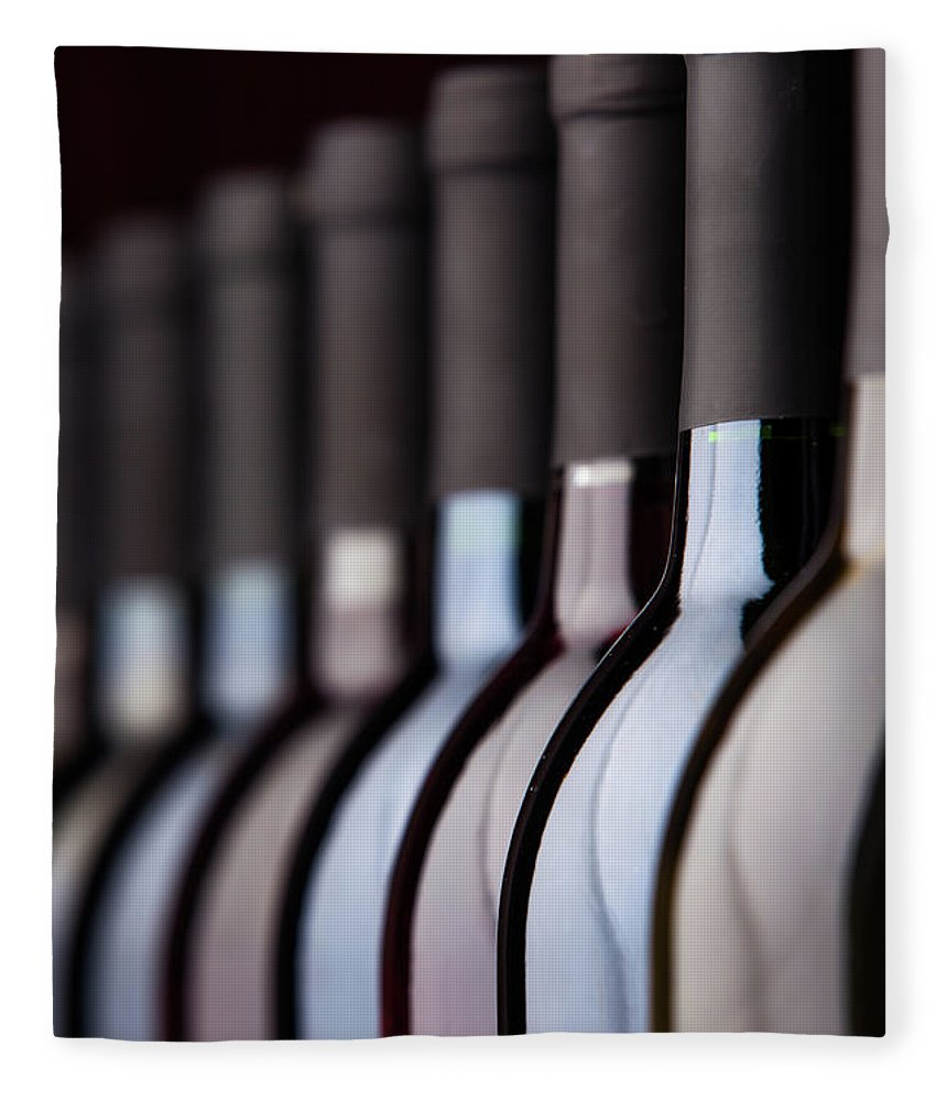 Alcohol Fleece Blanket featuring the photograph Bottles Of Wine In A Row by Halbergman