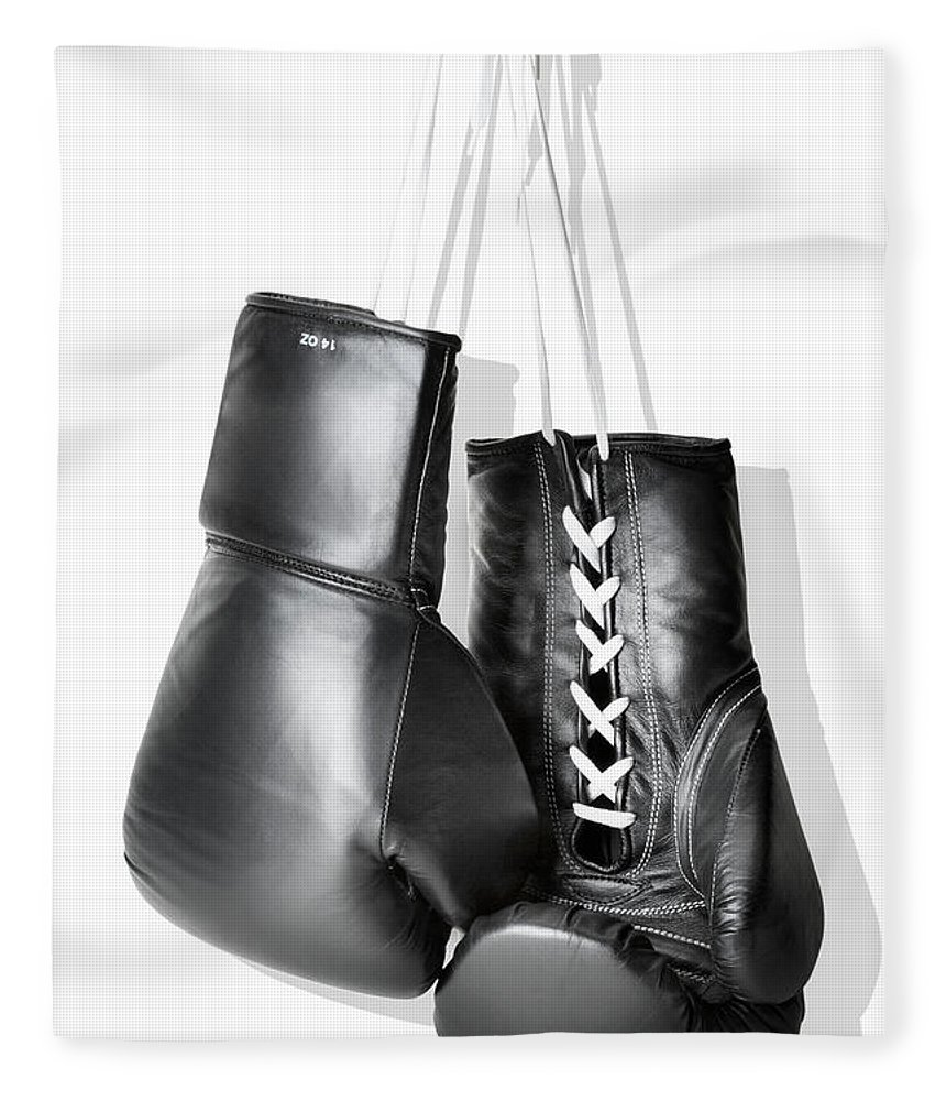 Hanging Fleece Blanket featuring the photograph Boxing Gloves Hanging Against White by Burazin
