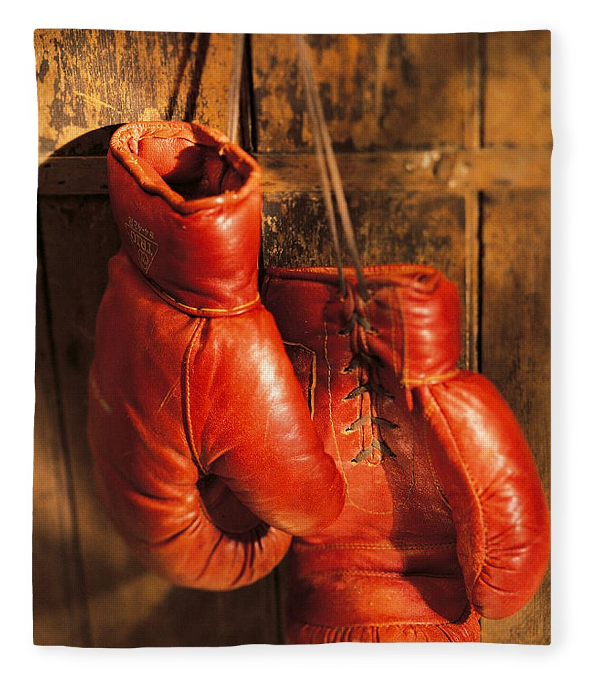 Hanging Fleece Blanket featuring the photograph Boxing Gloves Hanging On Rustic Wooden by Comstock