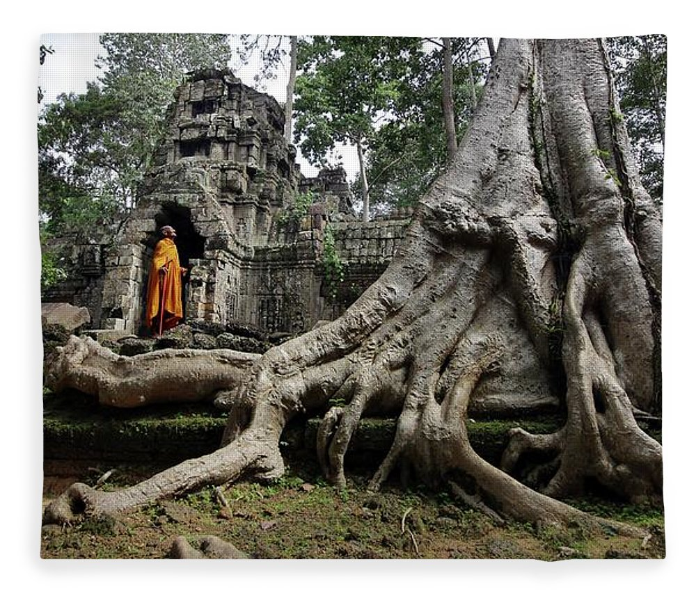 Orange Color Fleece Blanket featuring the photograph Buddhist Monk At Angkor Wat Temple by Timothy Allen