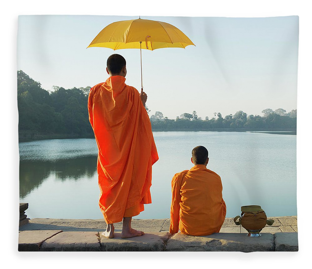 Young Men Fleece Blanket featuring the photograph Buddhist Monks Standing In Front Of by Martin Puddy