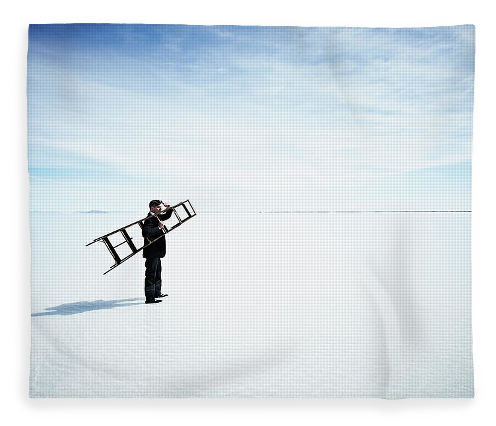 Scenics Fleece Blanket featuring the photograph Businessman Standing In Water Holding by Thomas Barwick