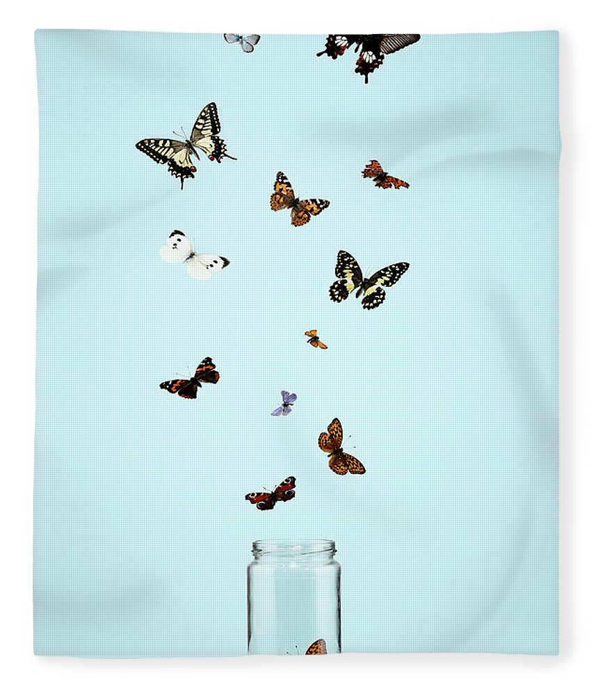 Animal Themes Fleece Blanket featuring the photograph Butterflies Escaping From Jar by Martin Poole