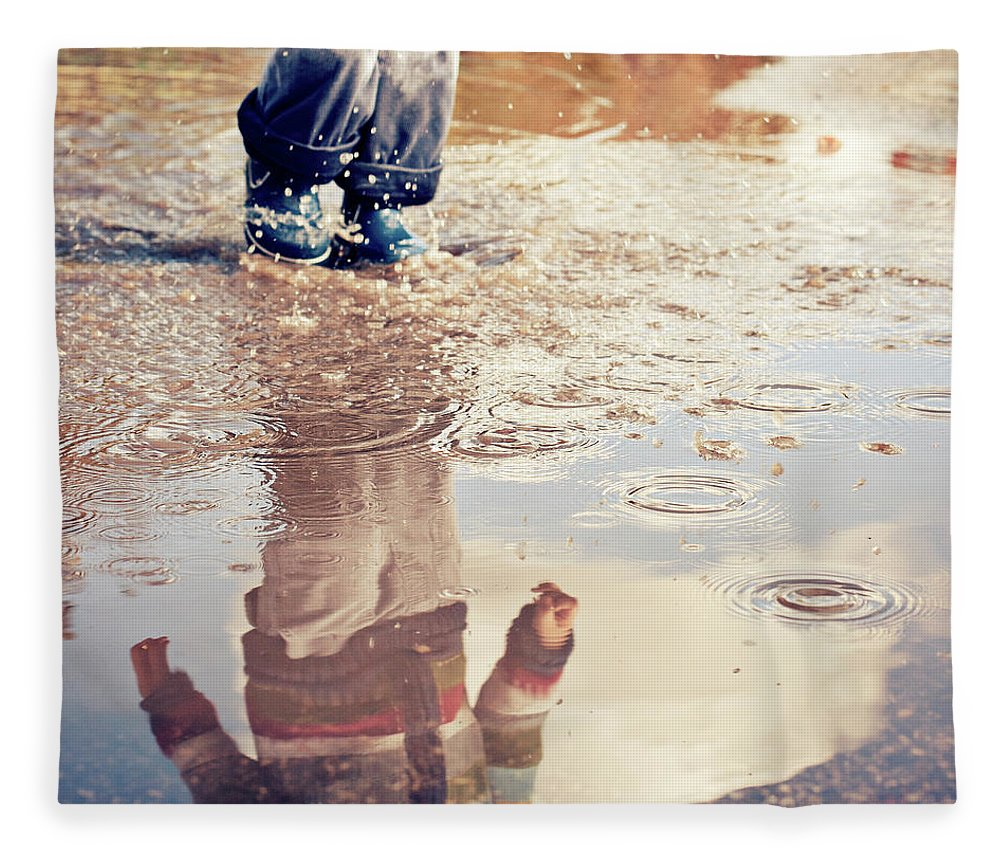 Toddler Fleece Blanket featuring the photograph Child In A Puddle by Vpopovic