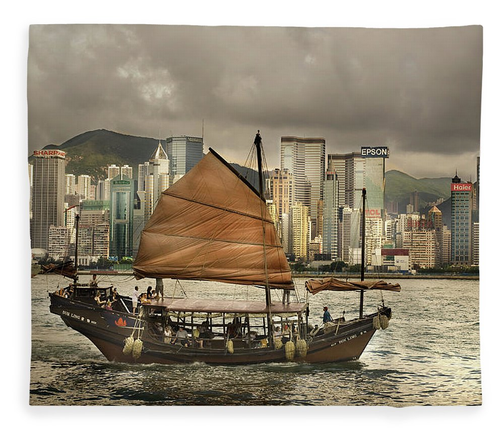 Sailboat Fleece Blanket featuring the photograph China, Hong Kong, Junk Boat In Bay by Maremagnum