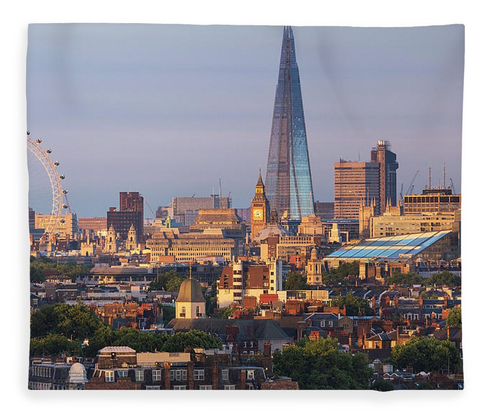 Tranquility Fleece Blanket featuring the photograph City Skyline In Late Evening Sunlight by Simon Butterworth