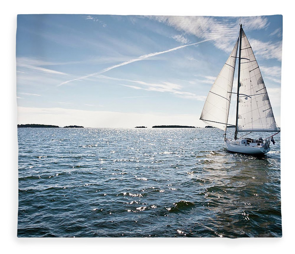 Recreational Pursuit Fleece Blanket featuring the photograph Classic Yacht Sailing Away Against Blue by Jaap-willem