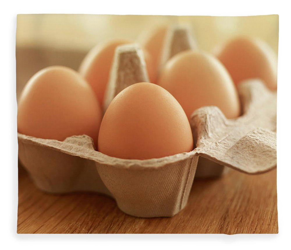 Free Range Fleece Blanket featuring the photograph Close Up Of Brown Eggs In Carton by Adam Gault