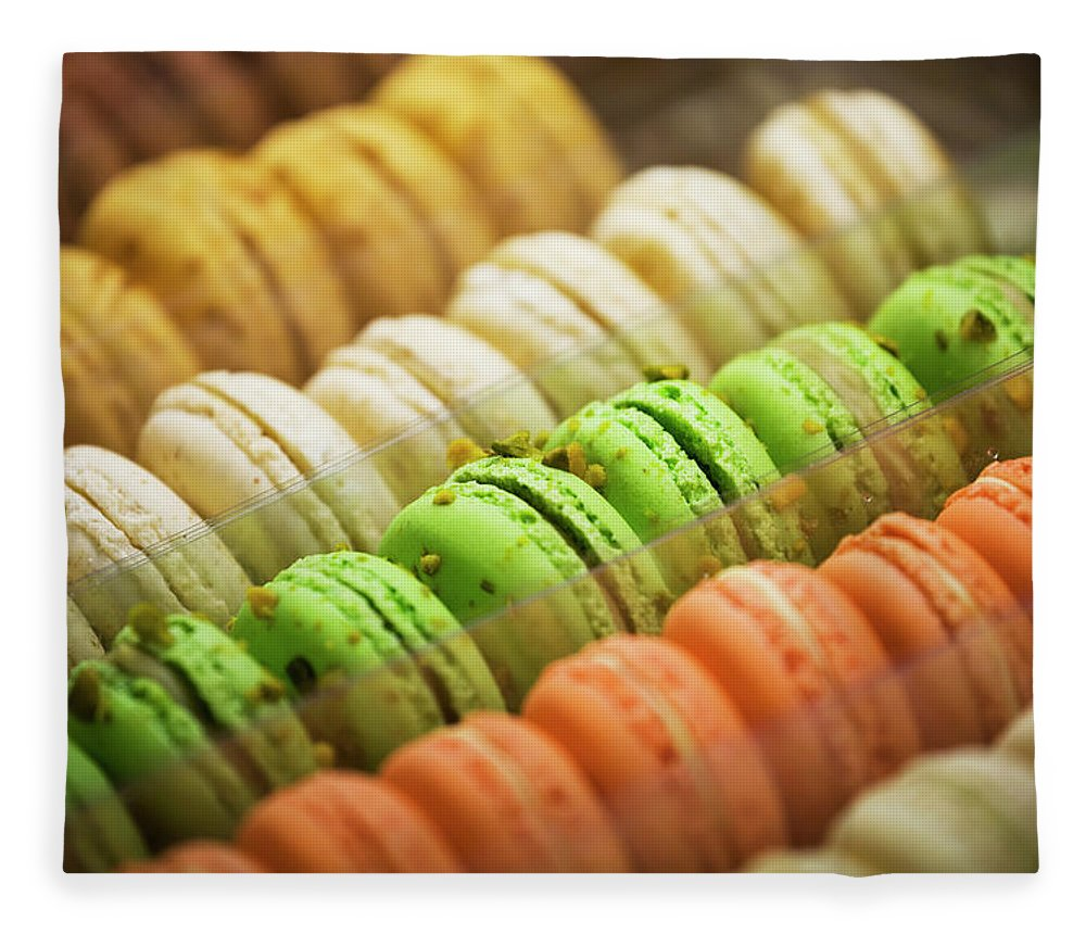 Unhealthy Eating Fleece Blanket featuring the photograph Close Up Of Coloured Macaroons In Store by Michael Interisano / Design Pics