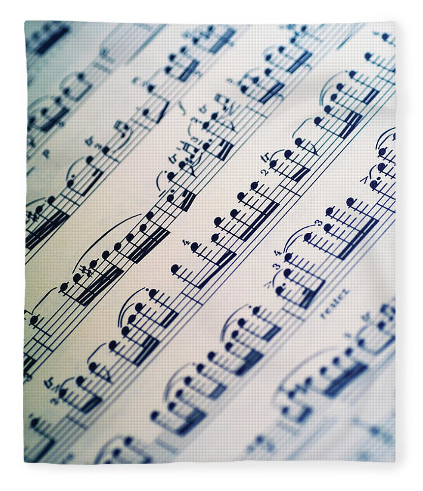 Sheet Music Fleece Blanket featuring the photograph Close-up Of Sheet Music by Medioimages/photodisc