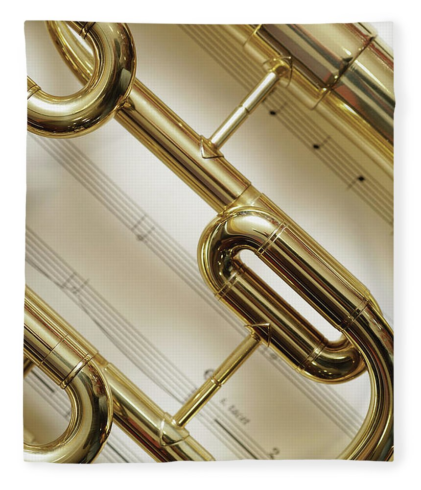Sheet Music Fleece Blanket featuring the photograph Close-up Of Trumpet by Medioimages/photodisc