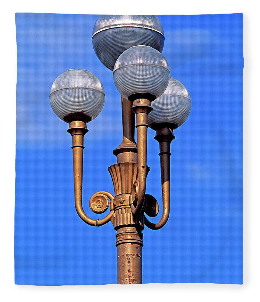 French Riviera Fleece Blanket featuring the photograph Closeup Of A Lamp by Murat Taner