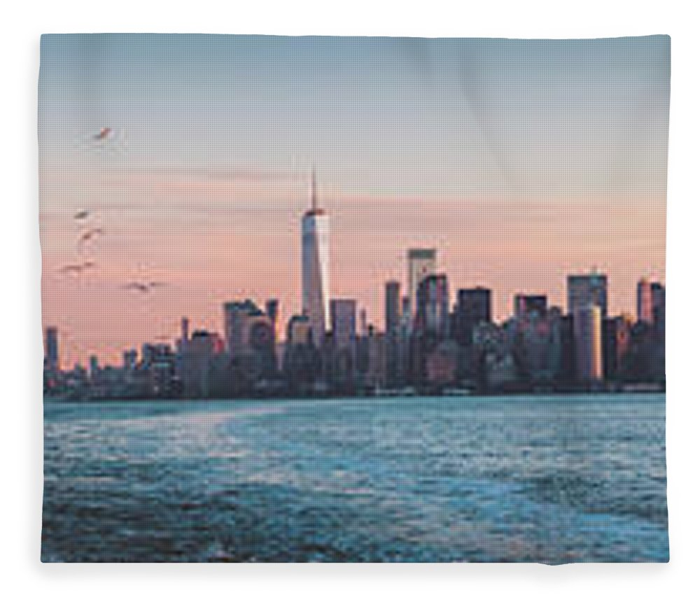 America Fleece Blanket featuring the photograph Colorful Sunrise Over The New York Skyline And The Statue Of Lib by PorqueNo Studios