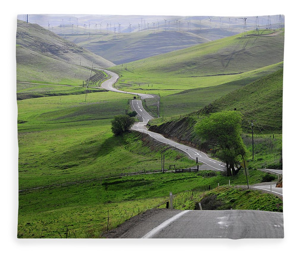 Scenics Fleece Blanket featuring the photograph Country Road Through Green Hills by Mitch Diamond