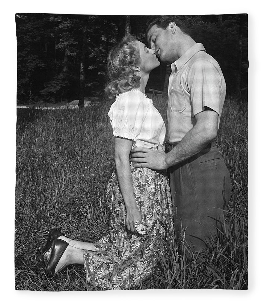 Heterosexual Couple Fleece Blanket featuring the photograph Couple Kissing Outdoors by George Marks