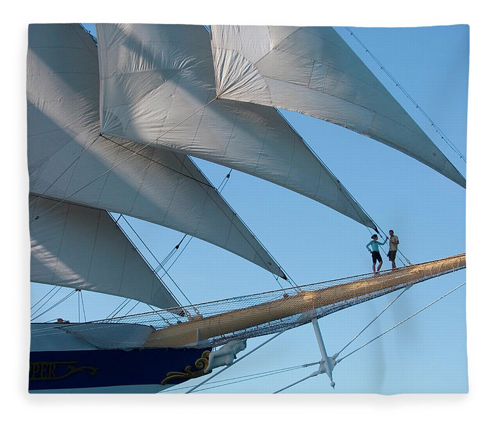 Heterosexual Couple Fleece Blanket featuring the photograph Couple On Bowsprit Of Sailing Ship by Holger Leue