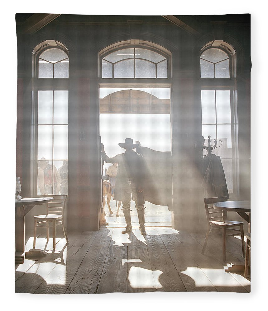 Shadow Fleece Blanket featuring the photograph Cowboy At Saloon by Matthias Clamer