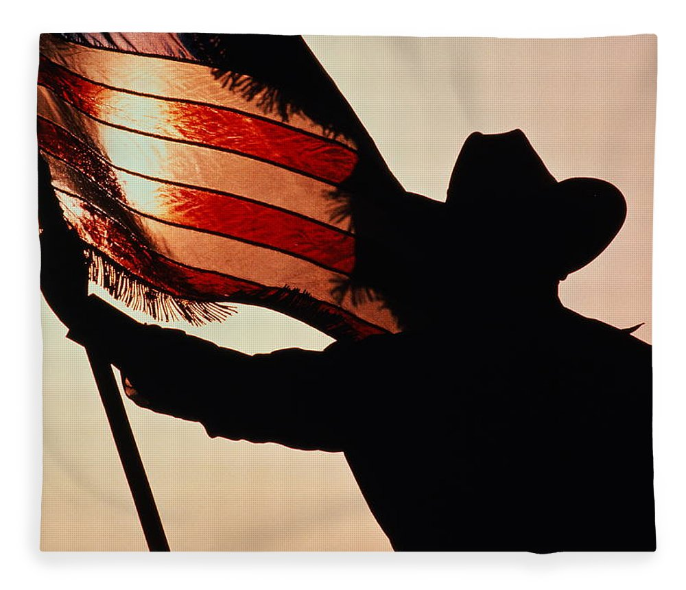 One Man Only Fleece Blanket featuring the photograph Cowboy Holding Stars And Stripes by Donovan Reese