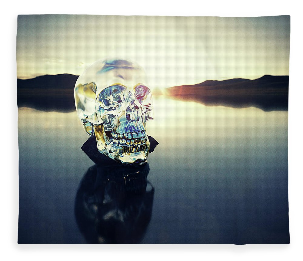 Art Fleece Blanket featuring the photograph Crystal Skull Laying On Rock In Lake by Doug Armand