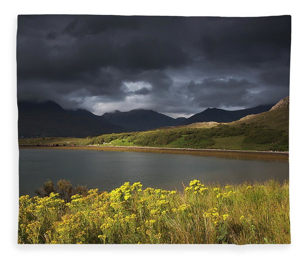 Tranquility Fleece Blanket featuring the photograph Dark Storm Clouds Hang Over The by John Short / Design Pics