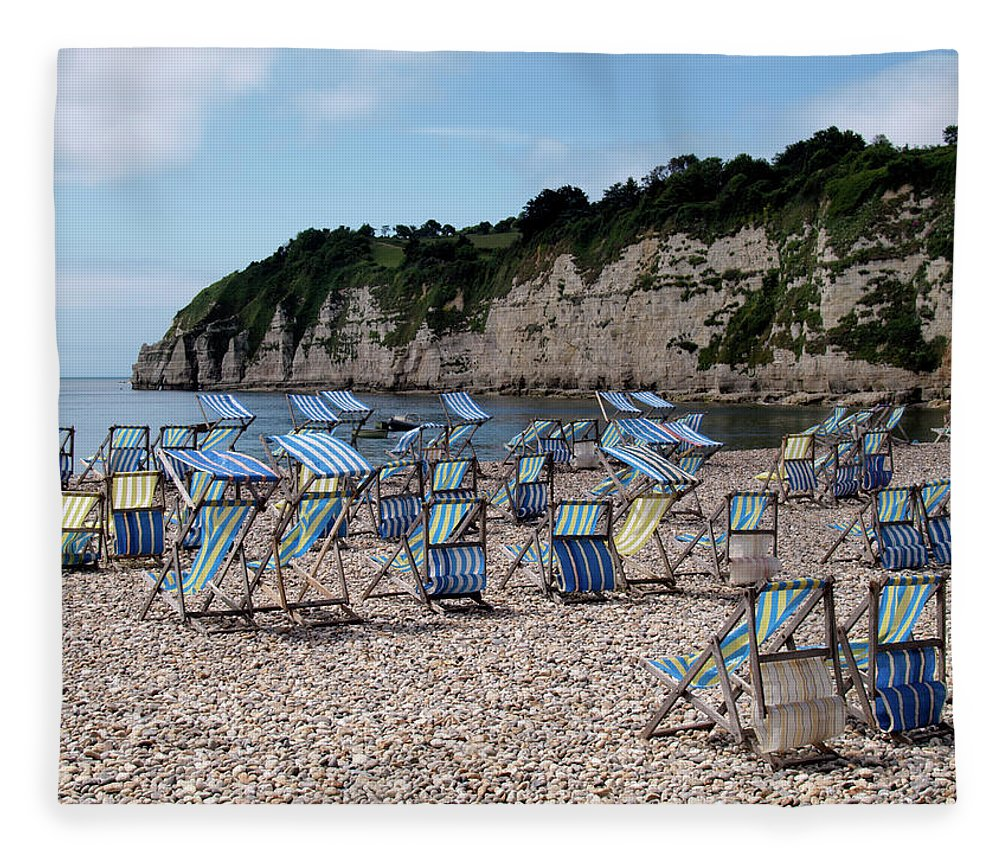 Tranquility Fleece Blanket featuring the photograph Deckchairs At Beer, Devon, Uk 2013 by Nik Taylor