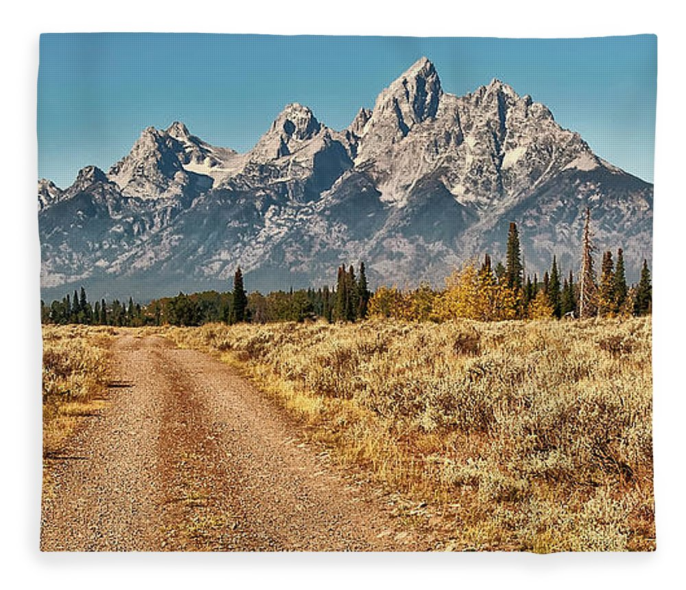Tranquility Fleece Blanket featuring the photograph Dirt Road To Tetons by Jeff R Clow
