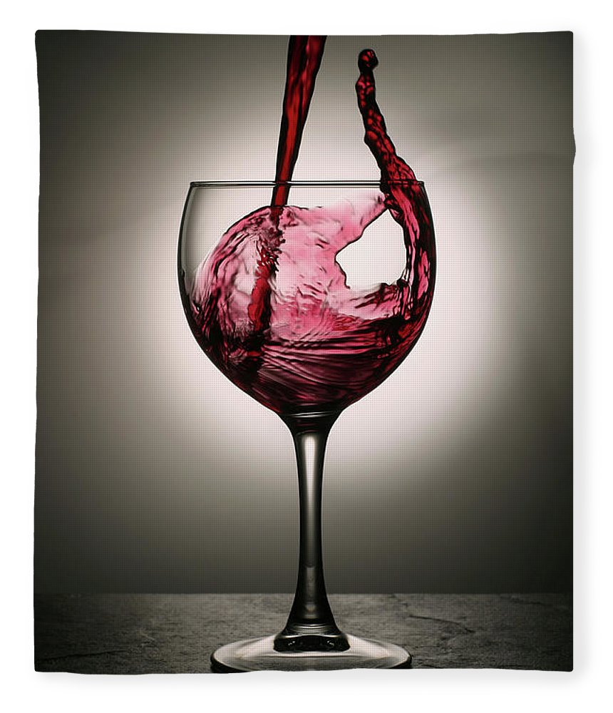 Alcohol Fleece Blanket featuring the photograph Dramatic Red Wine Splash Into Wine Glass by Donald gruener