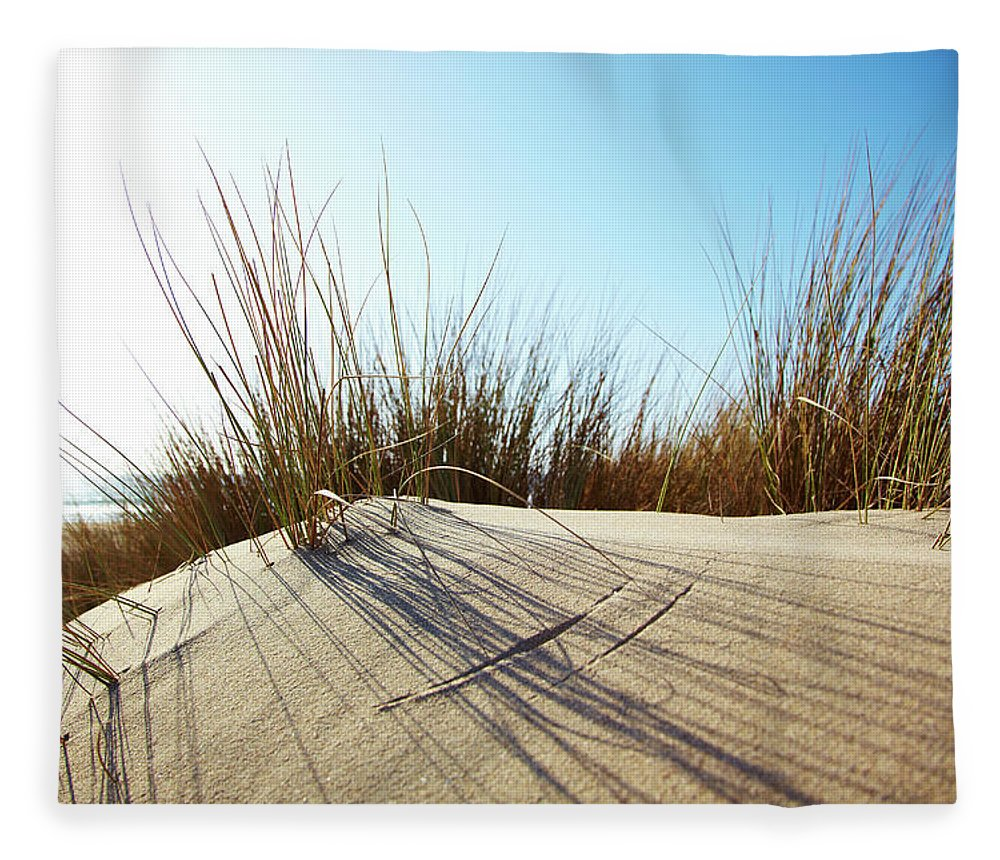 Tranquility Fleece Blanket featuring the photograph Dune Grass On A Sand Dune At The Beach by Thomas Northcut