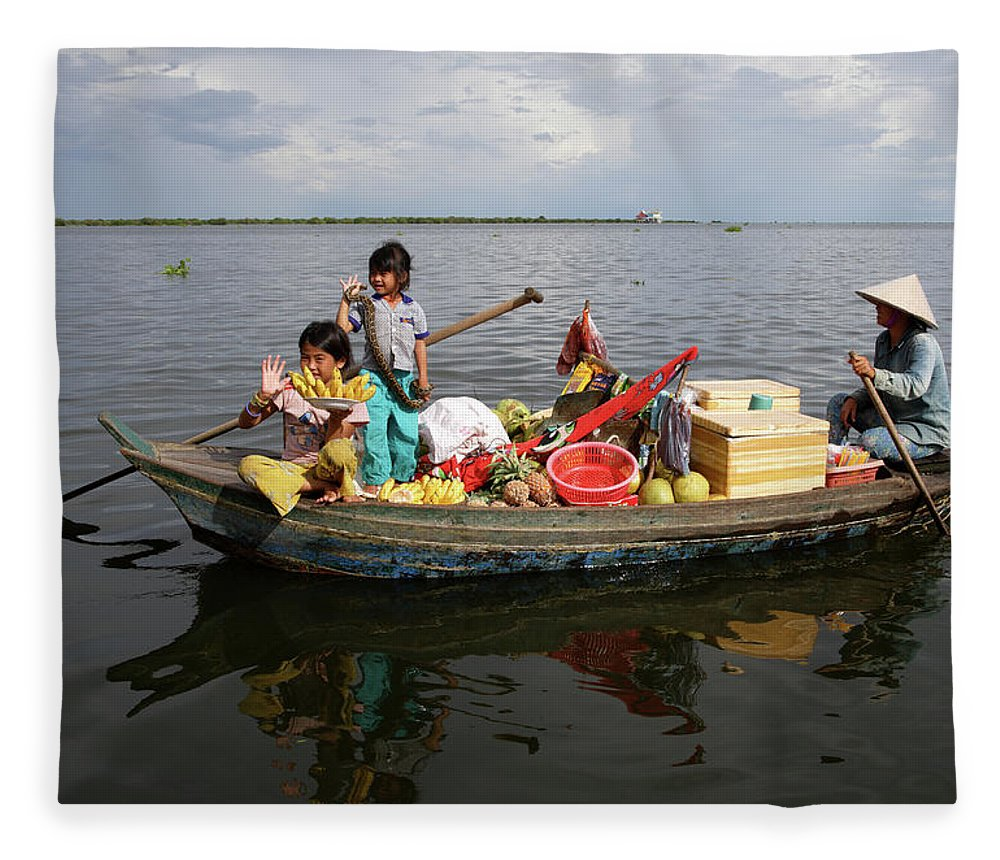 Child Fleece Blanket featuring the photograph Family & Snake Sell Wares On Tonle by Rosemary Calvert