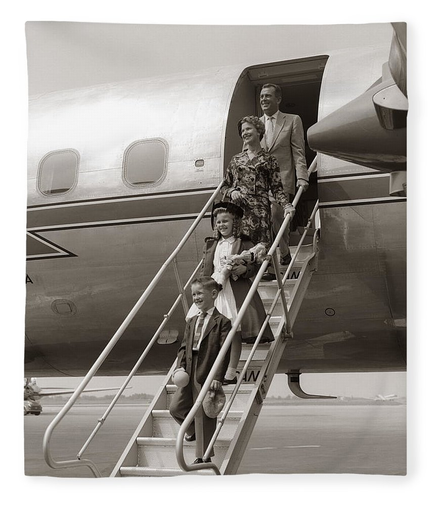 Steps Fleece Blanket featuring the photograph Family Walking Down Airplane Stairs by H. Armstrong Roberts