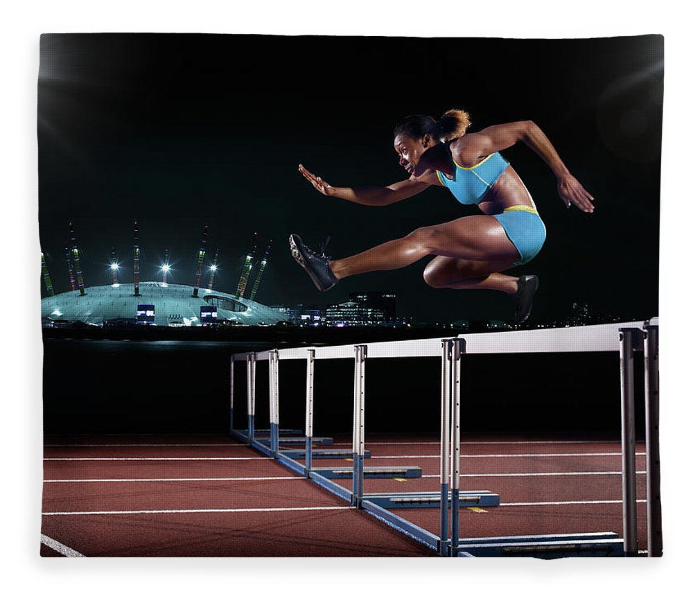 People Fleece Blanket featuring the photograph Female Hurdling In London by Mike Harrington