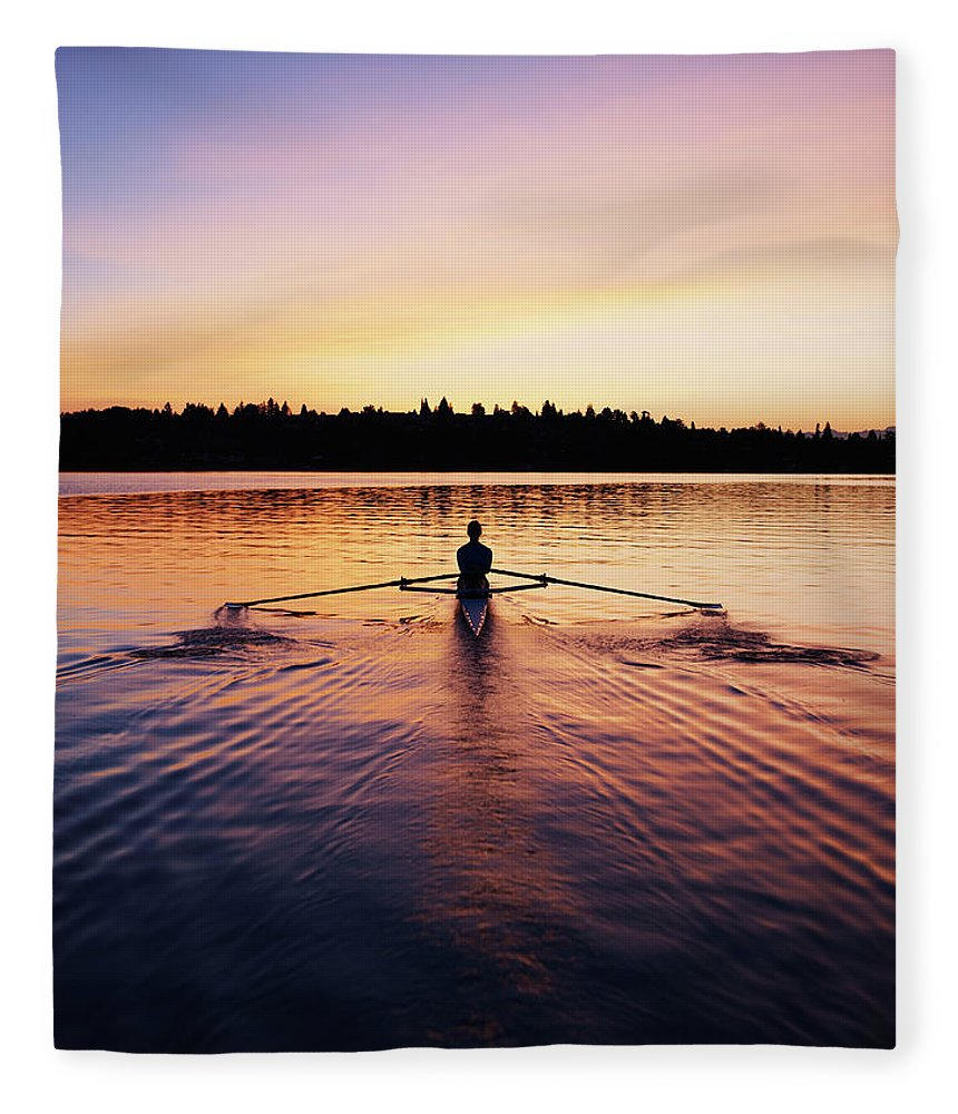 Tranquility Fleece Blanket featuring the photograph Female Rowing Single Scull, Sunrise by Thomas Barwick