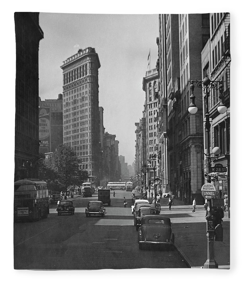 1950-1959 Fleece Blanket featuring the photograph Fifth Ave. And The Flatiron Bldg by George Marks