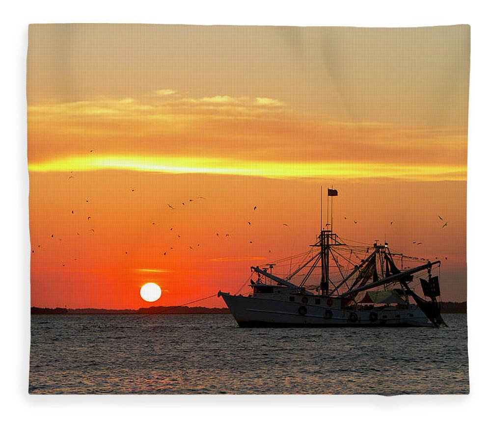 Water's Edge Fleece Blanket featuring the photograph Fishing Boat At Sunset by Tshortell