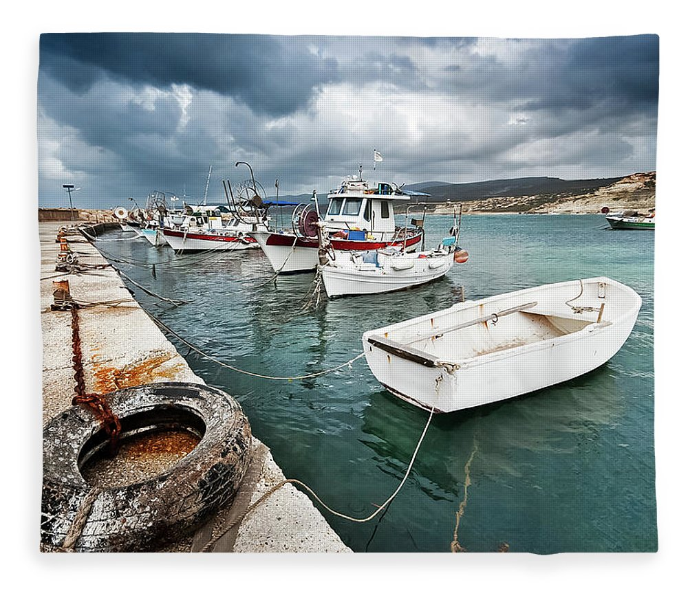 Seascape Fleece Blanket featuring the photograph Fishing Boats Along The Harbour Wall by Lee Stevens