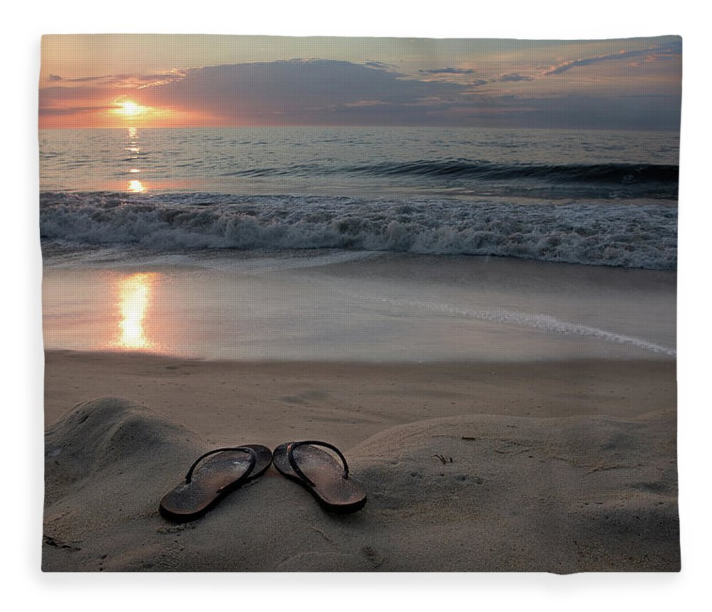 Water's Edge Fleece Blanket featuring the photograph Flip-flops On The Beach by Sdominick