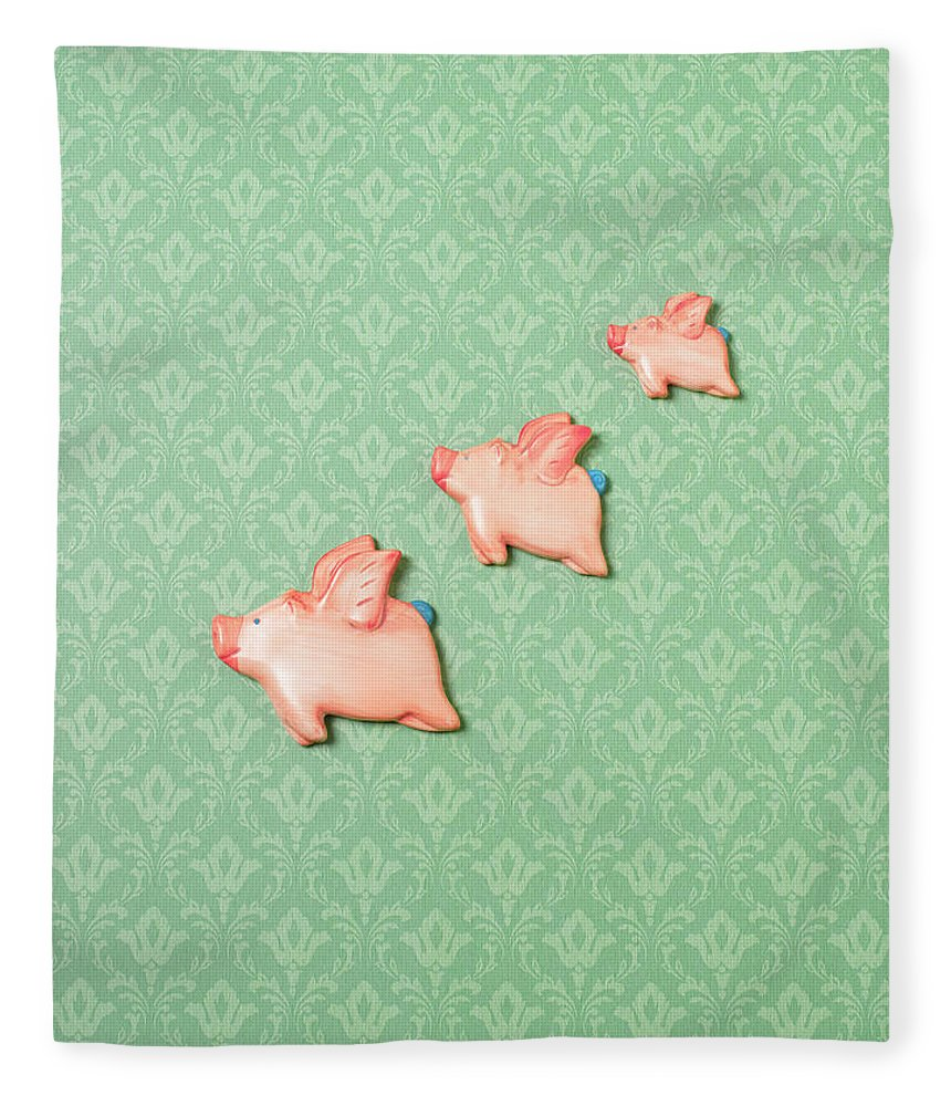 Disbelief Fleece Blanket featuring the photograph Flying Pig Ornaments On Wallpapered by Peter Dazeley