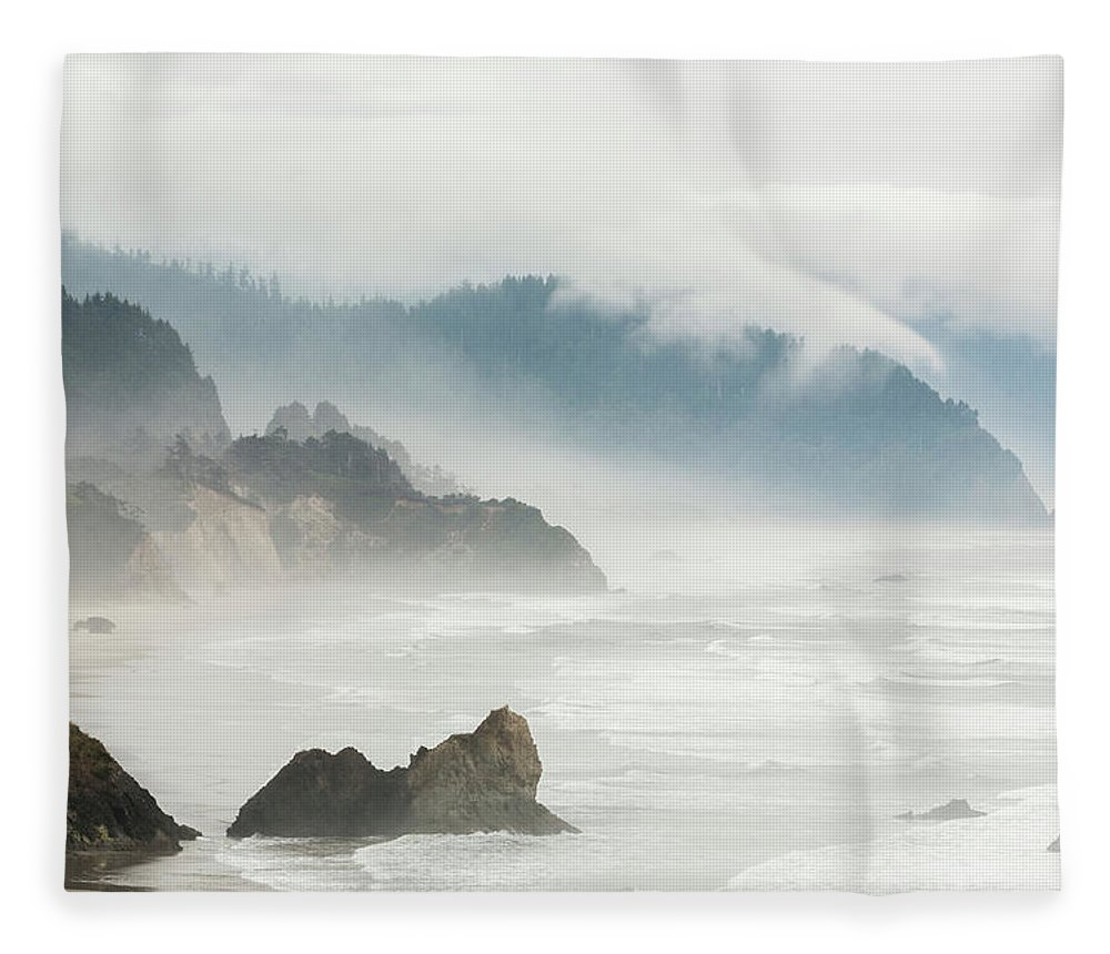 Scenics Fleece Blanket featuring the photograph Fog Shrouded View Of Rocky Coastline by Win-initiative