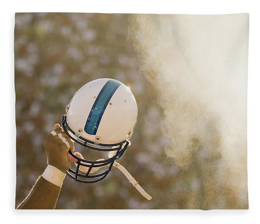 Celebration Fleece Blanket featuring the photograph Football Player Waving Helmet In Air by David Madison