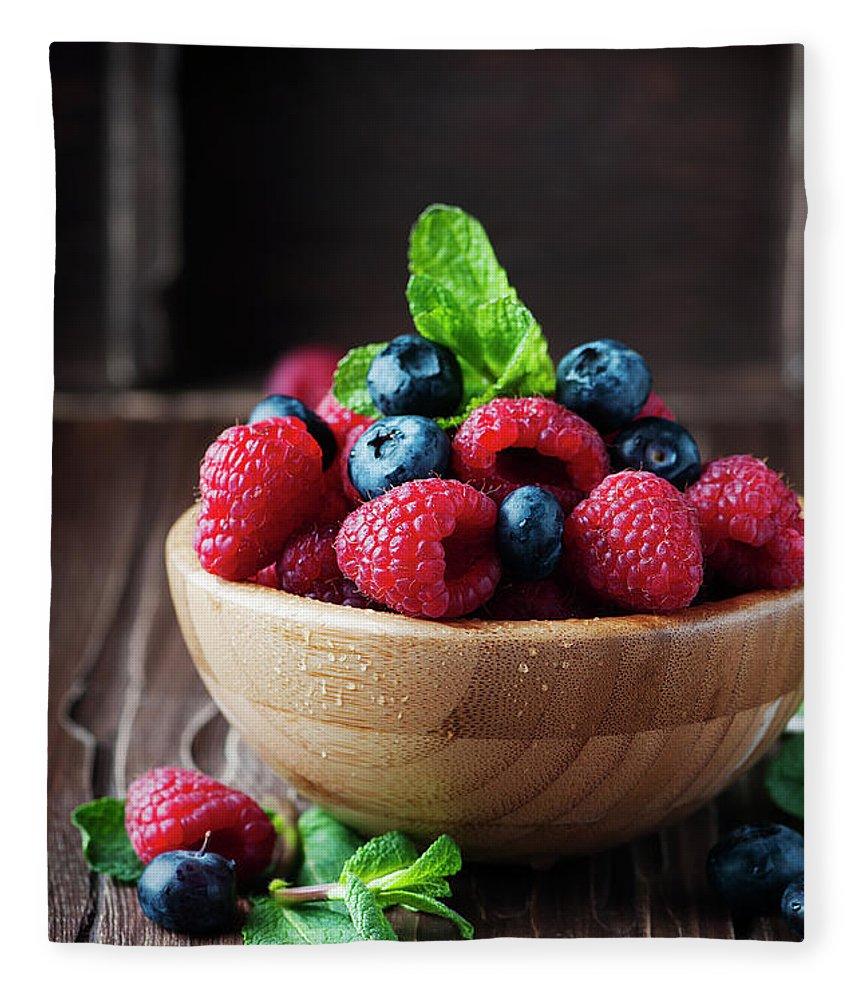 Vitamin Fleece Blanket featuring the photograph Fresh Sweet Raspberry And Bluberry by Oxana Denezhkina